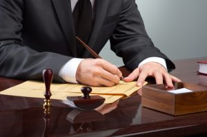 Attorney Signing Documents - best traffic ticket lawyers in springfield
